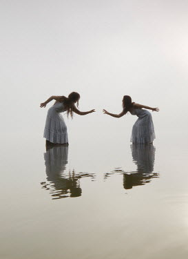 Leszek Paradowski TWO WOMEN DANCING IN OCEAN Women