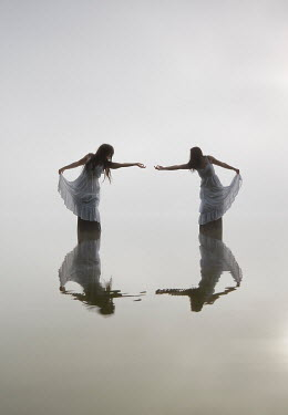 Leszek Paradowski TWO WOMAN DANCING IN OCEAN Women