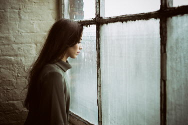 Mohamad Itani YOUNG BRUNETTE WOMAN LOOKING OUT WINDOW Women