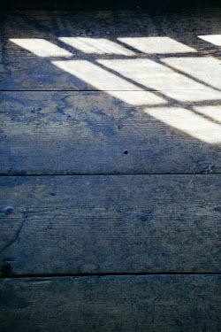 Irene Suchocki SUNLIT REFLECTION OF WINDOW ON WOOD Building Detail