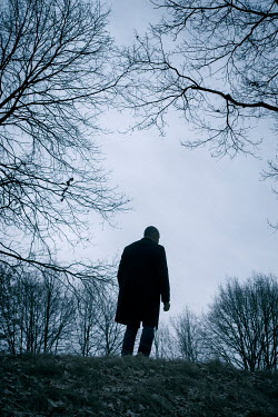 Mohamad Itani MAN IN BLACK COAT WALKING IN COUNTRYSIDE Men