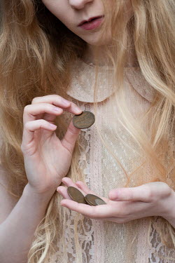 Rebecca Knowles YOUNG VINTAGE WOMAN HOLDING COINS Women