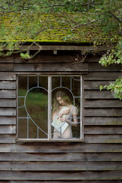 Rebecca Knowles VINTAGE WOMAN WITH LETTERS BEHIND CABIN WINDOW Women