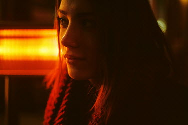Dmitriy Bilous CLOSE UP OF GIRL BY ORANGE LIGHT AT NIGHT Women