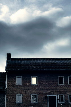 Ysbrand Cosijn House with illuminated window under cloudy sky Houses