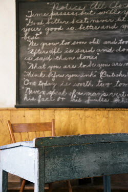 Irene Suchocki DESK AND BLACKBOARD IN VINTAGE SCHOOL ROOM Interiors/Rooms