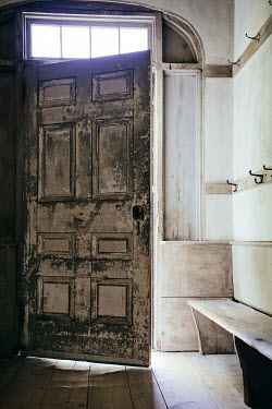 Irene Suchocki HALLWAY WITH PEELING WOODEN DOOR Interiors/Rooms