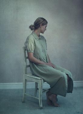 Mark Owen VINTAGE WOMAN SITTING IN EMPTY ROOM Women