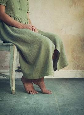 Mark Owen BAREFOOT WOMAN SITTING IN EMPTY ROOM Women