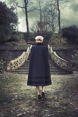 Robin Macmillan BLONDE VINTAGE NURSE WALKING IN GARDEN Women