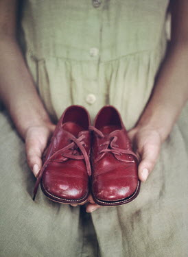 Mark Owen VINTAGE WOMAN HOLDING CHILDS RED SHOES Women