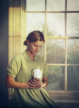 Mark Owen YOUNG VINTAGE WOMAN WITH LETTER BESIDE WINDOW Women