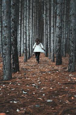 Robin Macmillan BRUNETTE WOMAN RUNNING IN WINTRY FOREST Women