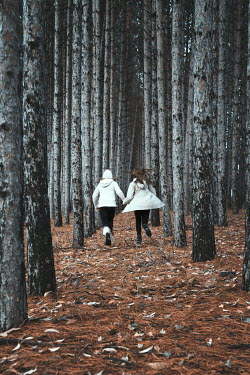 Robin Macmillan TWO GIRLS RUNNING IN WINTRY FOREST Women