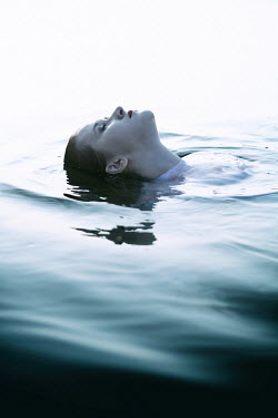 Magdalena Russocka womans face in water Women