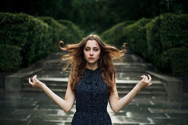 Dmitriy Bilous YOUNG BRUNETTE WOMAN FLICKING HAIR Women