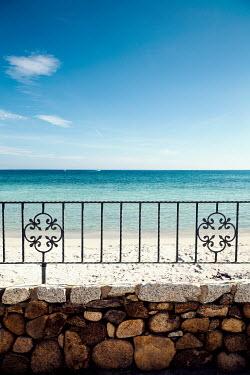 Yolande de Kort SUMMER SEA BEHIND STONE WALL Seascapes/Beaches