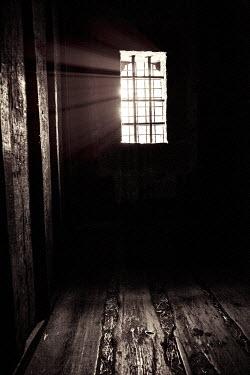 Yolande de Kort SUNLIT WINDOW IN SHADOWY DUNGEON Interiors/Rooms