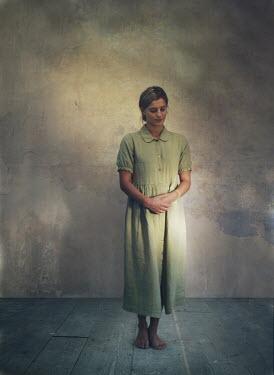 Mark Owen VINTAGE WOMAN STANDING IN SHABBY ROOM Women