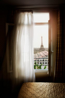 Yolande de Kort VIEW OF EIFFEL TOWER THROUGH BEDROOM WINDOW Miscellaneous Cities/Towns