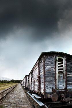 Yolande de Kort HISTORICAL TRAIN ON COUNTRYSIDE PLATFORM Railways/Trains