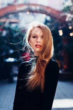 Daniel Bidiuk WOMAN WITH LONG BLONDE HAIR IN STREET Women