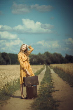 Daniel Bidiuk BLONDE GIRL WITH SUITCASES IN COUNTRYSIDE Women