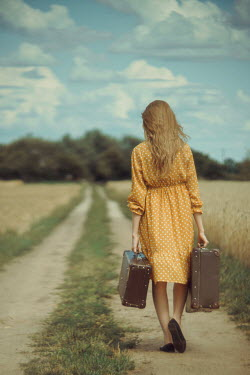 Daniel Bidiuk GIRL WALKING WITH SUITCASES IN COUNTRYSIDE Women