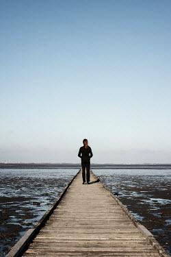 Manuela Deigert WOMAN ON JETTY WATCHING SEA Women