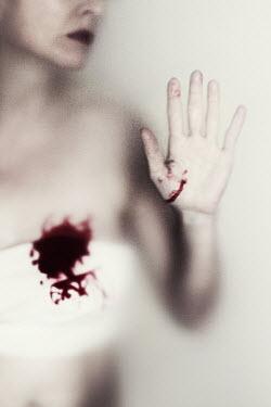 Manuela Deigert WOMAN BEHIND GLASS WITH BLOODSTAIN Women