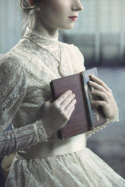 Magdalena Russocka HISTORICAL WOMAN HOLDING BOOK INDOORS Women