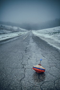 Magdalena Russocka abandoned spinning top on country road in winter Miscellaneous Objects