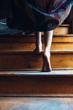 Daniel Bidiuk BAREFOOT WOMAN CLIMBING WOODEN STEPS Women