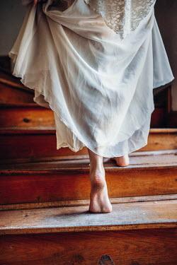Daniel Bidiuk BAREFOOT WOMAN CLIMBING WOODEN STAIRS Women