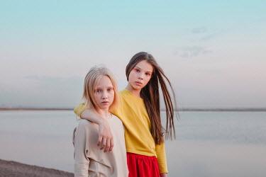 Dasha Pears TWO GIRLS STANDING NEAR WATER Children