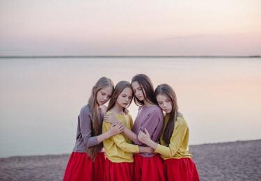 Dasha Pears FOUR GIRLS EMBRACING ON BEACH Children