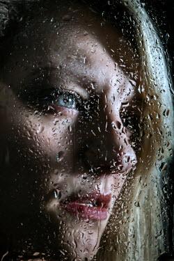 Stephen Carroll WOMAN LOOKING THROUGH WET WINDOW Women