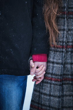 Magdalena Russocka close up of couple holding hands in winter Couples