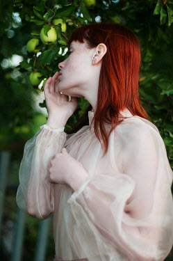 Tatiana Mertsalova GIRL WITH RED HAIR BY APPLE TREE Women
