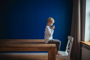 Dasha Pears LITTLE BOY SITTING ON TABLE DRINKING Children
