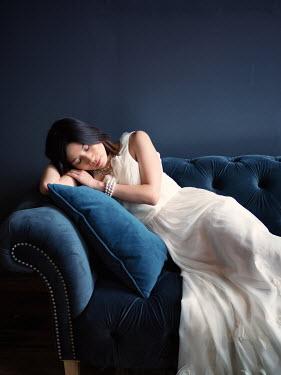 Elisabeth Ansley WOMAN SLEEPING ON SOFA Women