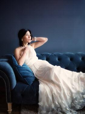 Elisabeth Ansley WOMAN SITTING ON SOFA Women