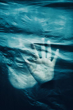 Magdalena Russocka trapped woman behind plastic sheet Women