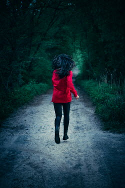 Magdalena Russocka young woman in red jacket running in forest Women