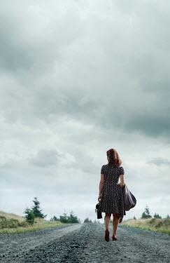 Stephen Mulcahey RETRO WOMAN WALKING ON ROAD Women