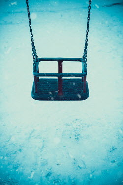 Ildiko Neer Empty swing in snow