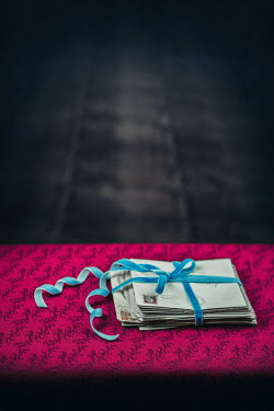 Magdalena Russocka bundle of letters tied with blue ribbon