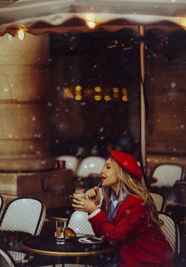 Marta Syrko WOMAN SITTING OUTSIDE CAFE Women