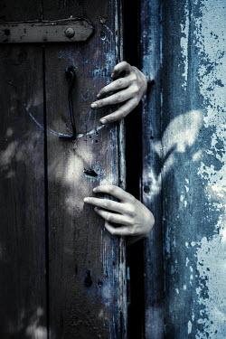 Magdalena Russocka spooky hands opening door Women