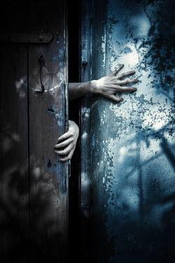 Magdalena Russocka sinister hands opening door Women